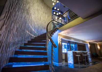 entertainment room and bar with staircase