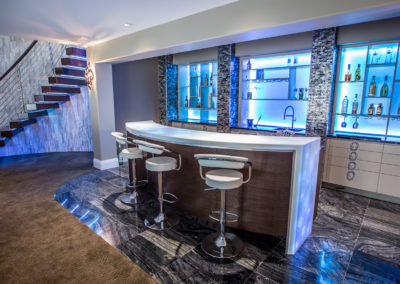 entertainment room and bar in lower level of a home