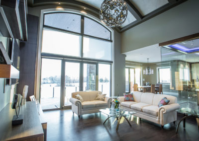 huge living room with picture window two stories tall