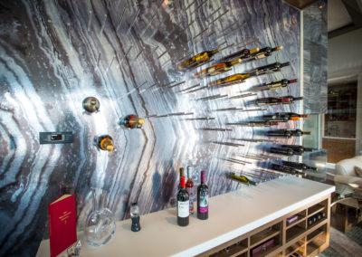 a wine cooler mural and countertop - modern design