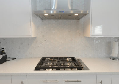 kitchen with a stainless steel oven hood.